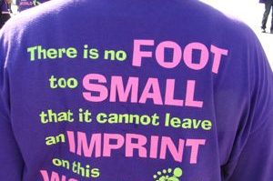 March of Dimes - purple shirt inscription: There is no foot to small that it cannot leave an imprint on this world.