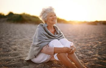 Older Woman Sitting on the Beach